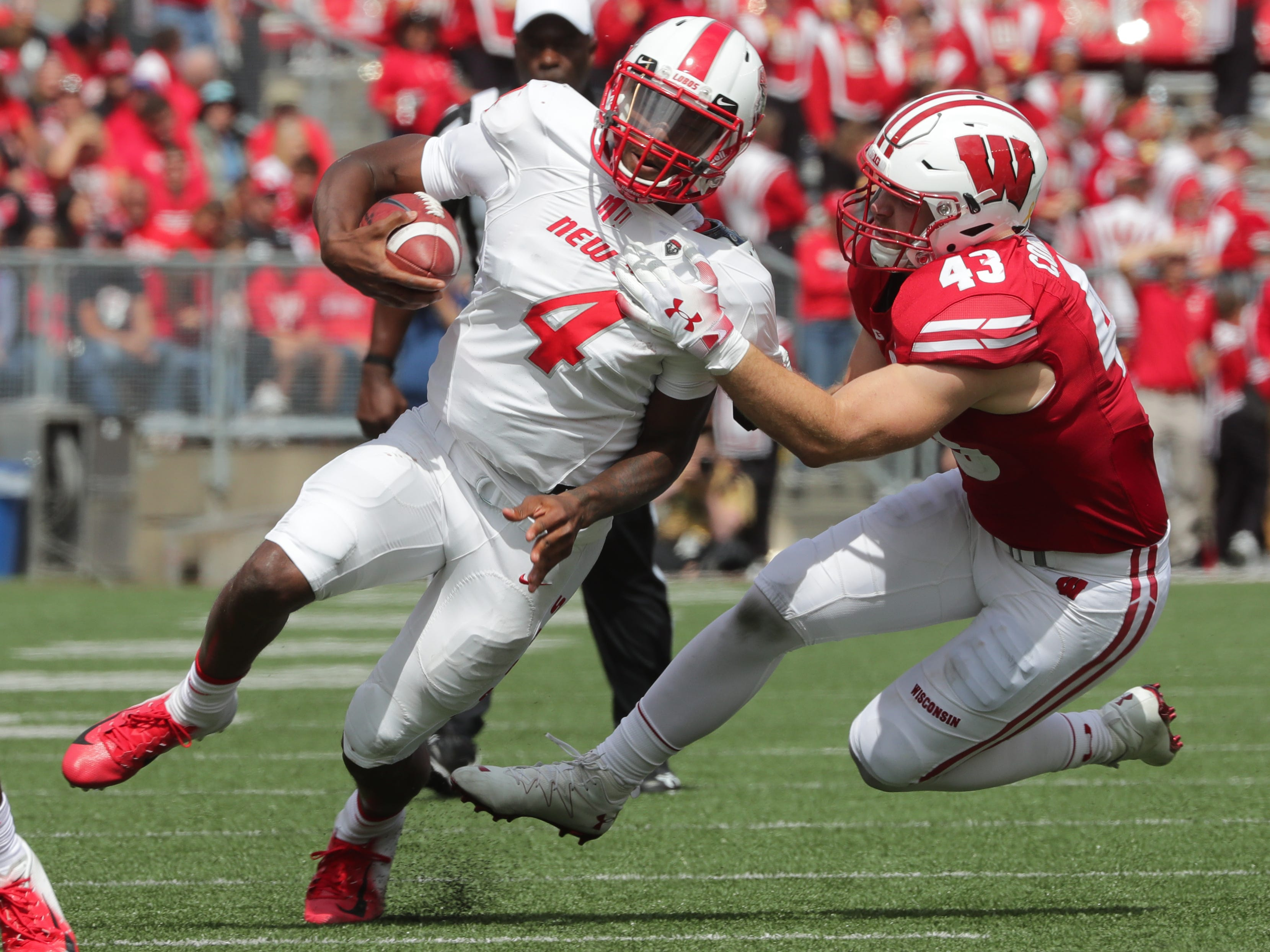 Wisconsin linebacker Ryan Connelly  drops New Mexico quarterback Sheriron Jones for a loss.