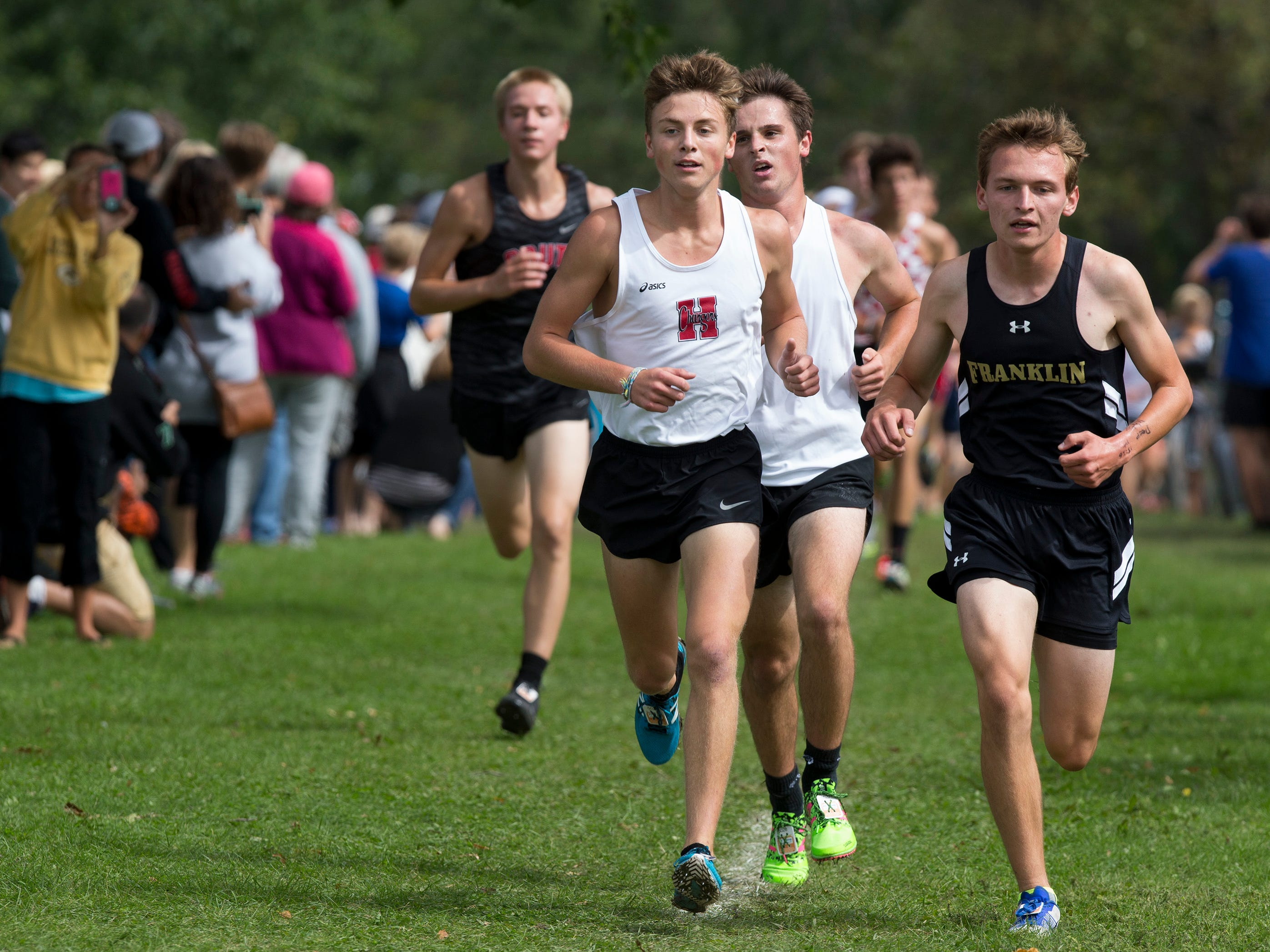Sussex Hamilton's Gavin Kuhlenbeck (center) and Franklin's Bryce Tome (right) run step in step in the first half of the Menomonee Falls Matt Hadler Cross Country Invitational Sept. 8 at Rotary Park. Kuhlenbeck finished first and Hadler second of 100 runners.