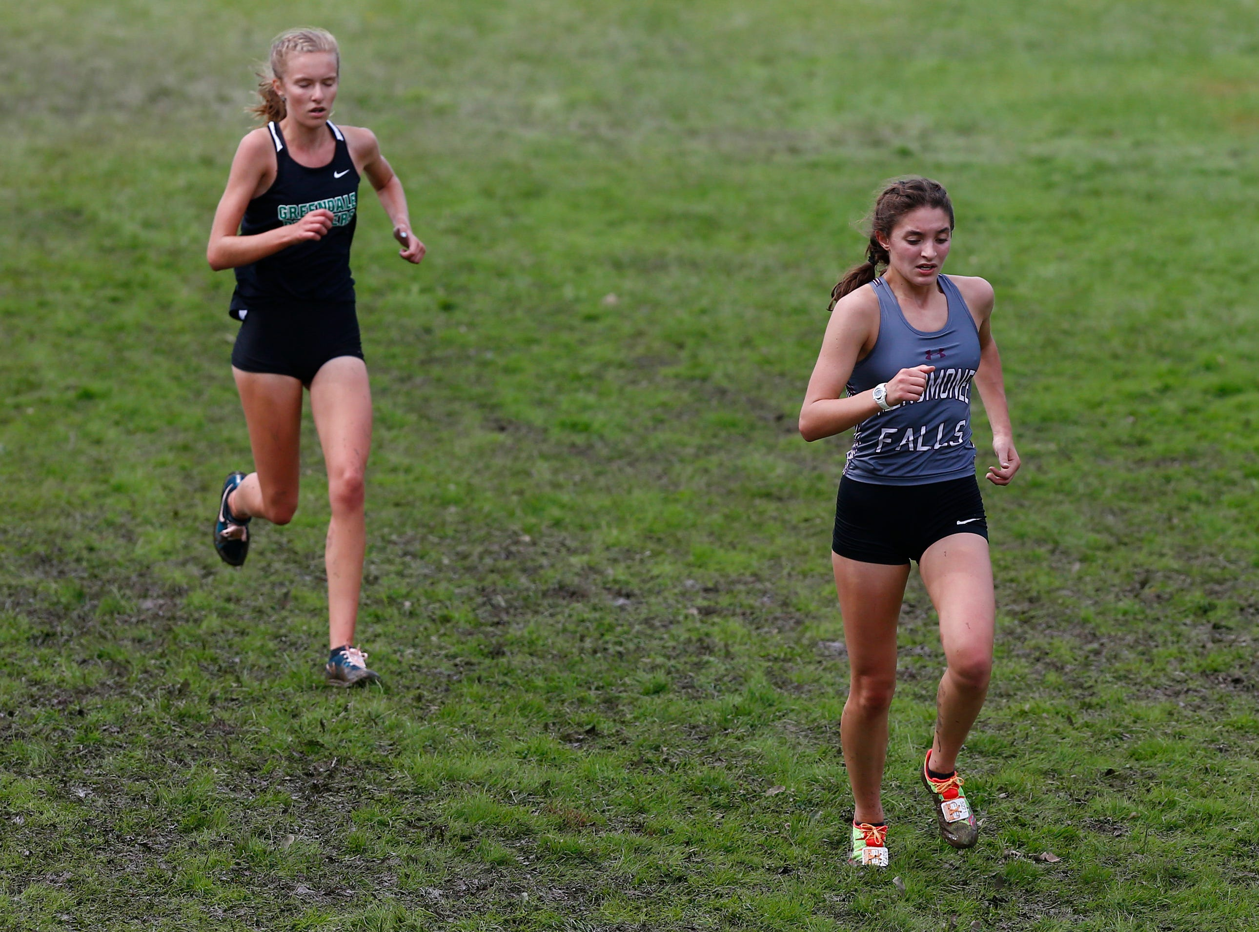 Greendale's Kelsey Sodemann (left) trails Menomonee Falls' Eileen Tocco head into the final stretch of the Menomonee Falls Matt Hadler Cross Country Invitational Sept. 8 at Rotary Park. Tocco finished 14th and Sodemann 15th of 76 runners.