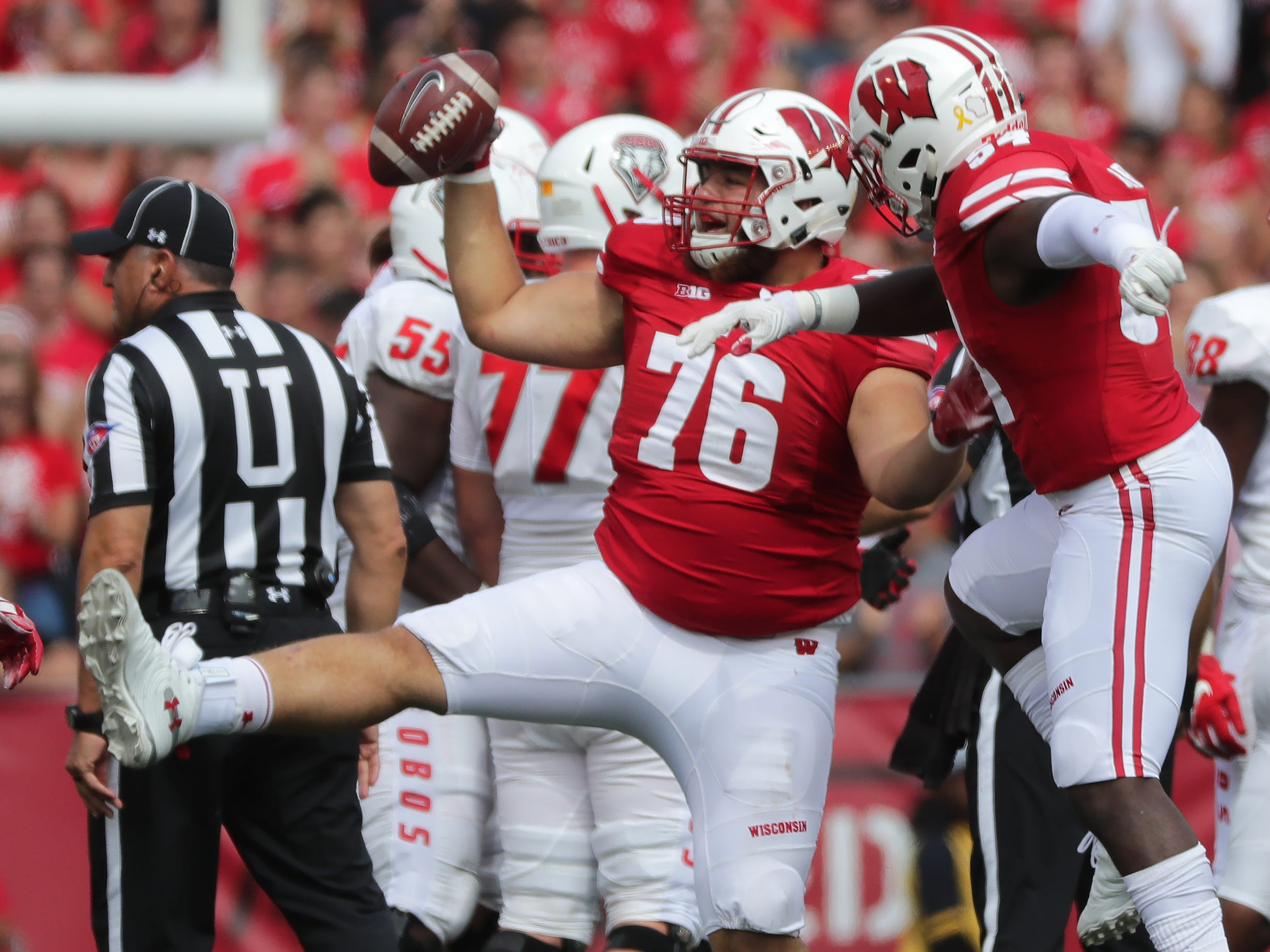 Wisconsin nose tackle Kayden Lyles  celebrates his recovery of a fuble in the third quarter.