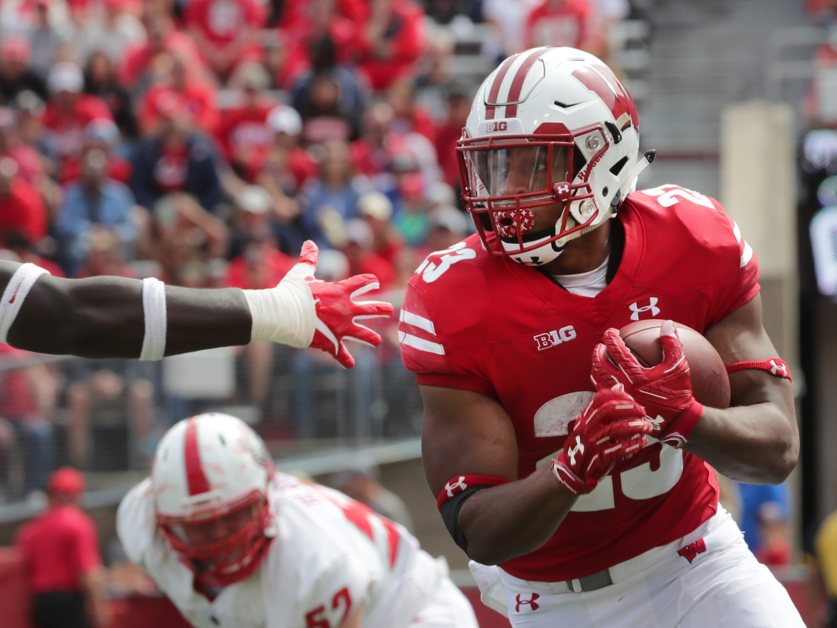 Wisconsin running back Jonathan Taylor  eludes New Mexico defensive lineman Nahje Flowers.