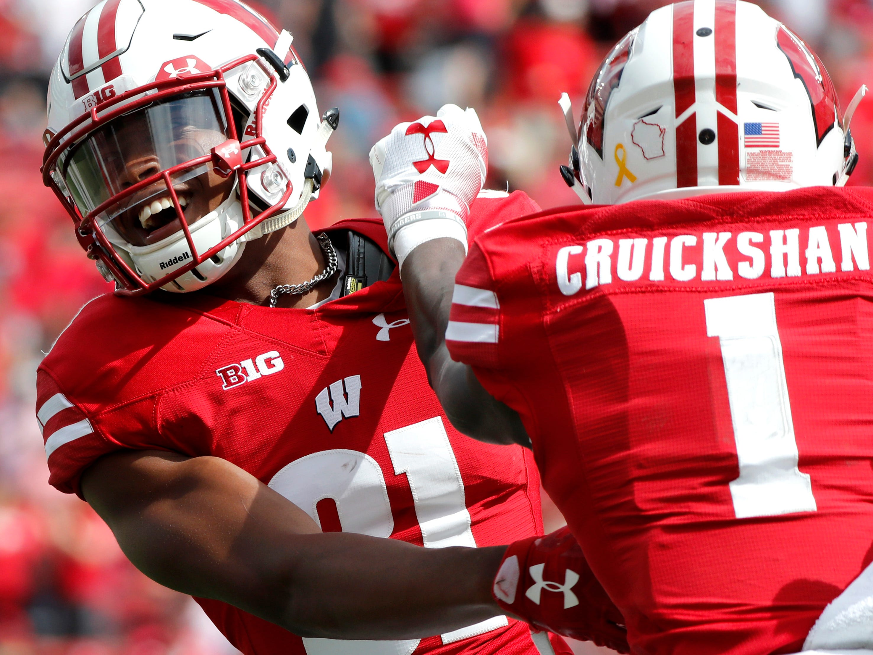 Wisconsin wide receiver Taj Mustapha celebrates his touchdown with Wisconsin wide receiver Aron Cruickshank.