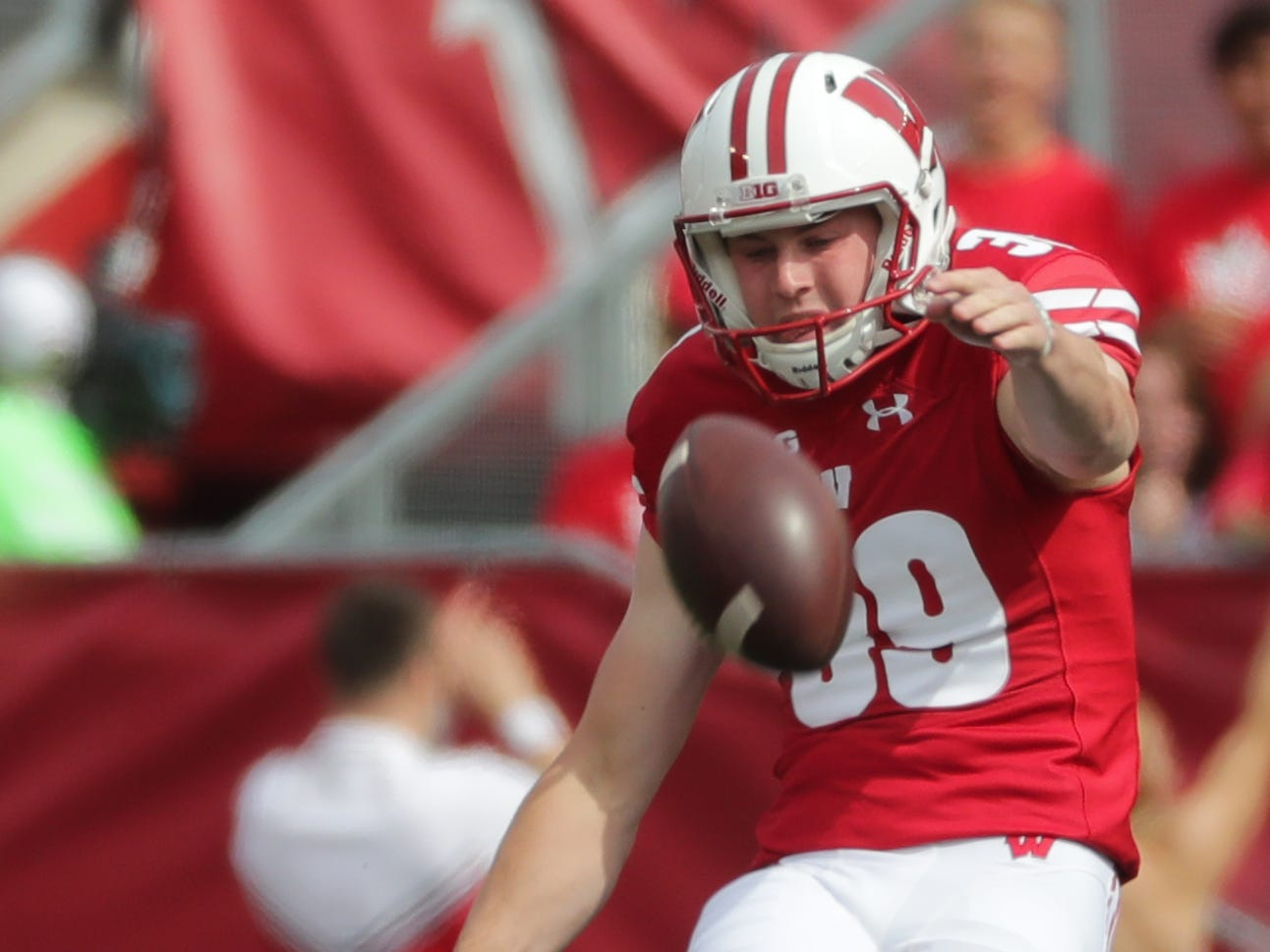 Wisconsin place kicker Zach Hintze kicks off during the first quarter.
