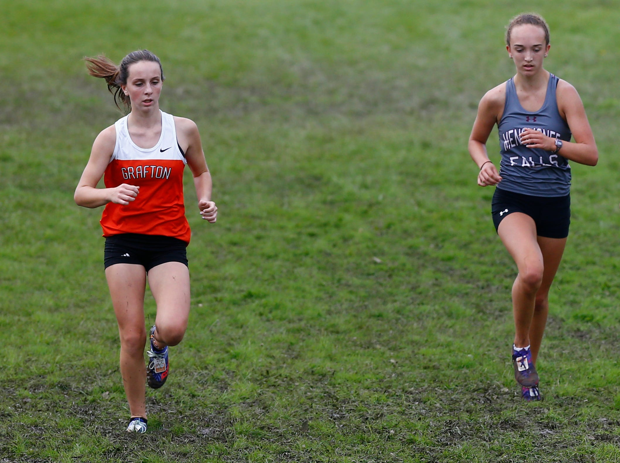 Grafton's Julia Wille (left) and Menomonee Falls' Olivia Robinson head into the final stretch of the Menomonee Falls Matt Hadler Cross Country Invitational at Rotary Park. Wille finished 24th. Robinson was 21st of 76 runners on Sept. 8.