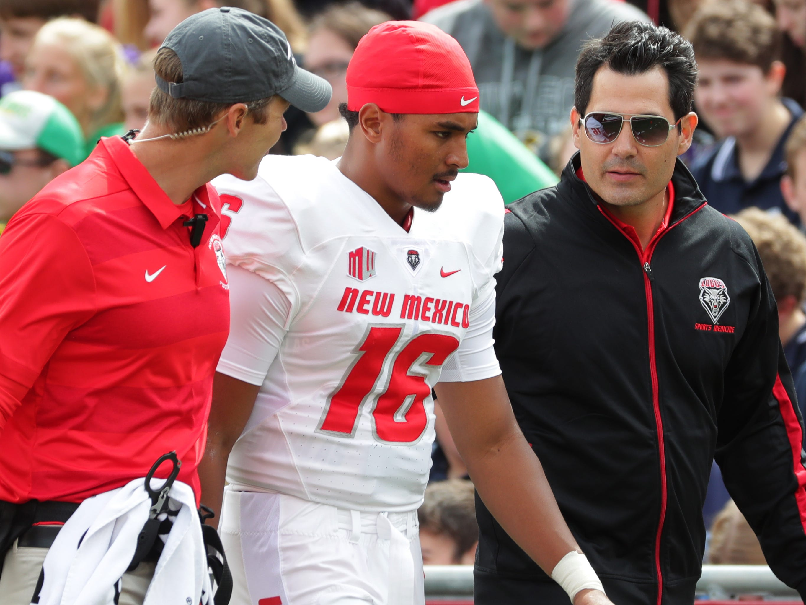New Mexico quarterback Tevaka Tuioti leaves the field during the second quarter.