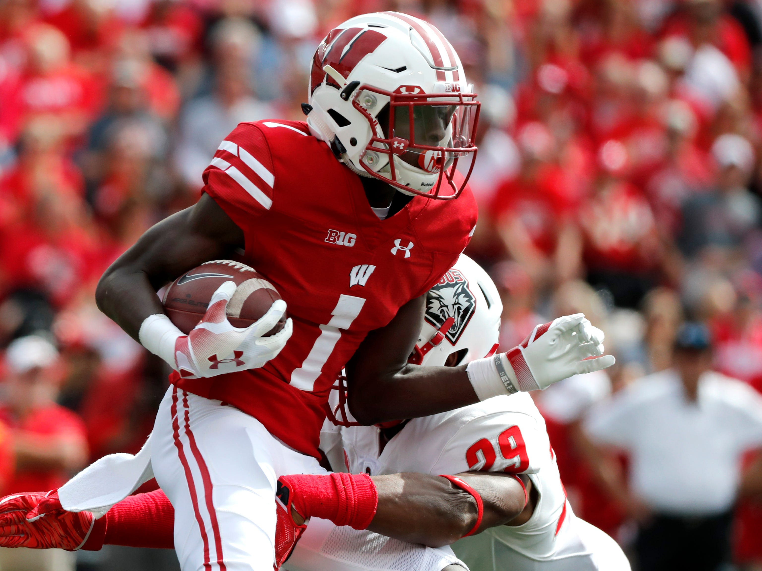 Wisconsin wide receiver Aron Cruickshank tries to break a tackle.