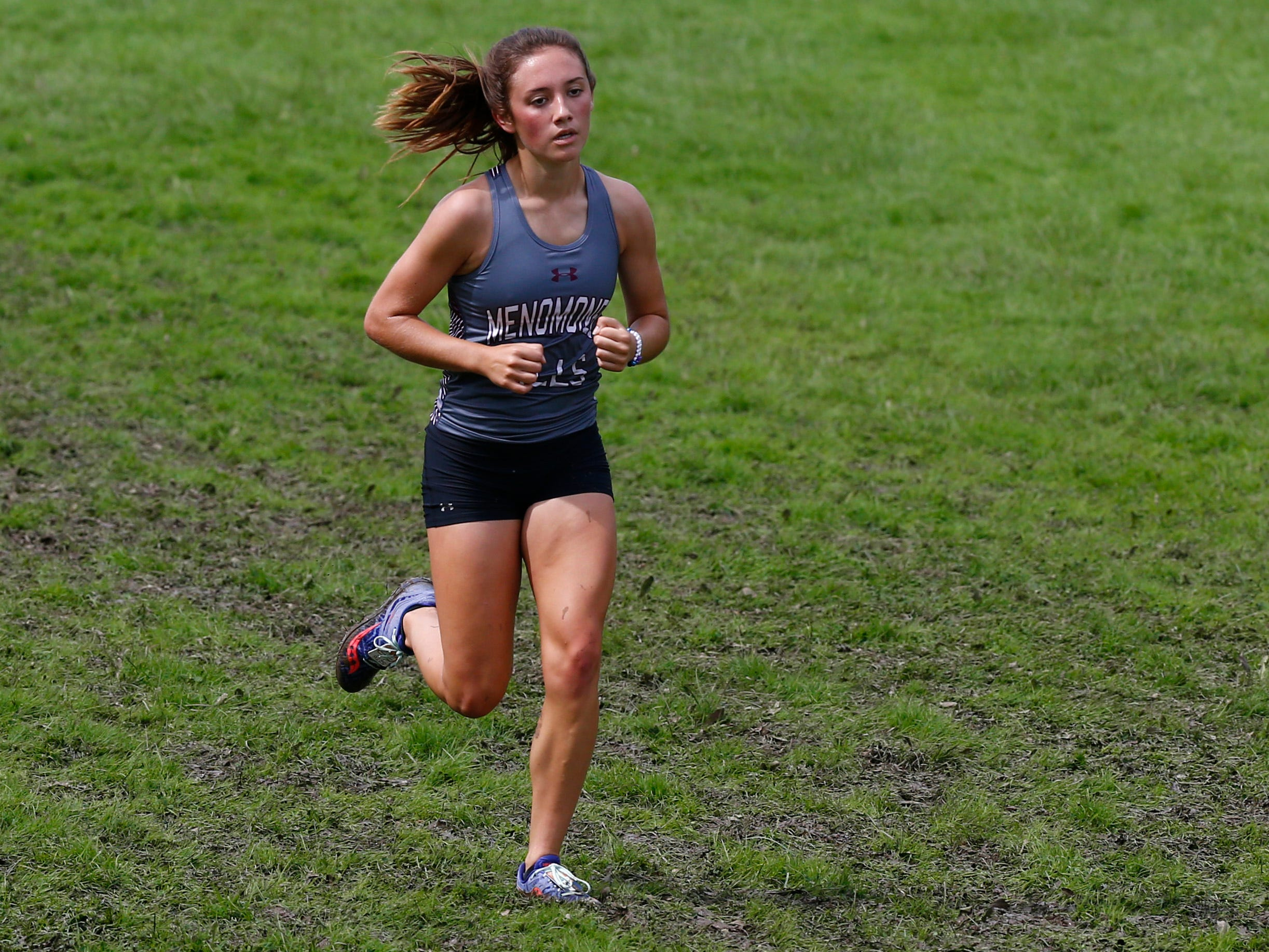 Menomonee Fall's Kylee Reeves heads into the final stretch of the Menomonee Falls Matt Hadler Cross Country Invitational at Rotary Park where she finished fourth of 76 runners on Sept. 8.