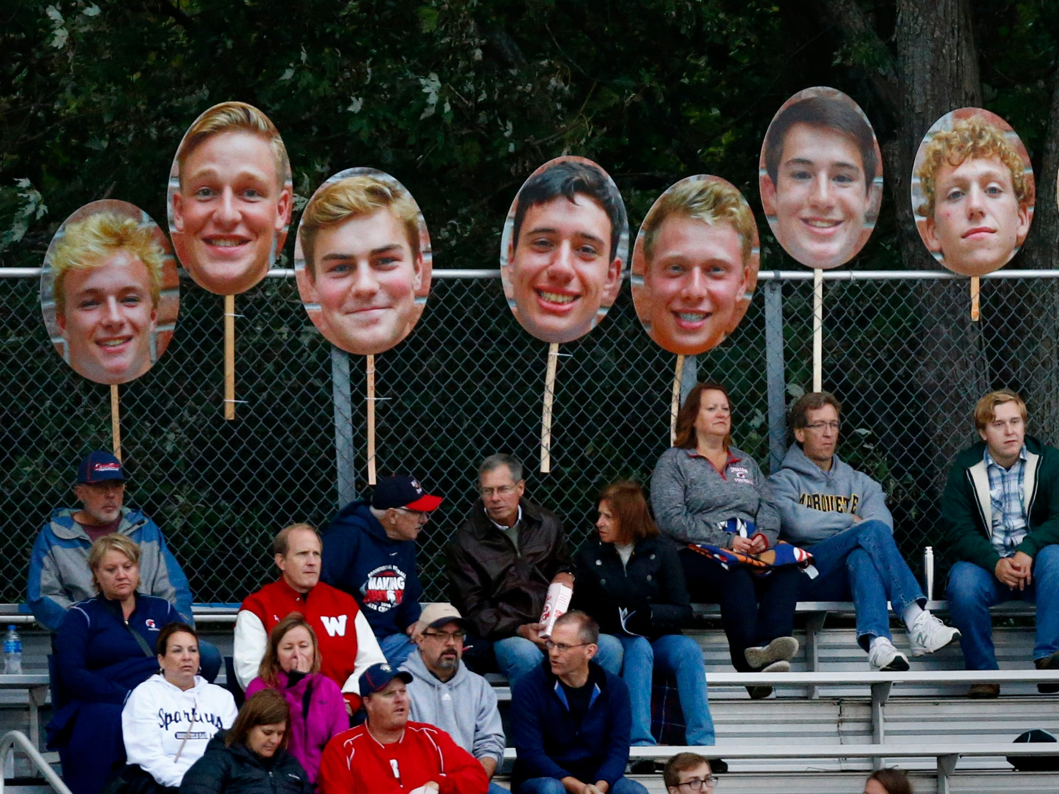 Brookfield East parents post a gallery of their players at the top of the stands in a game against Sussex Hamilton at East on Sept. 7.