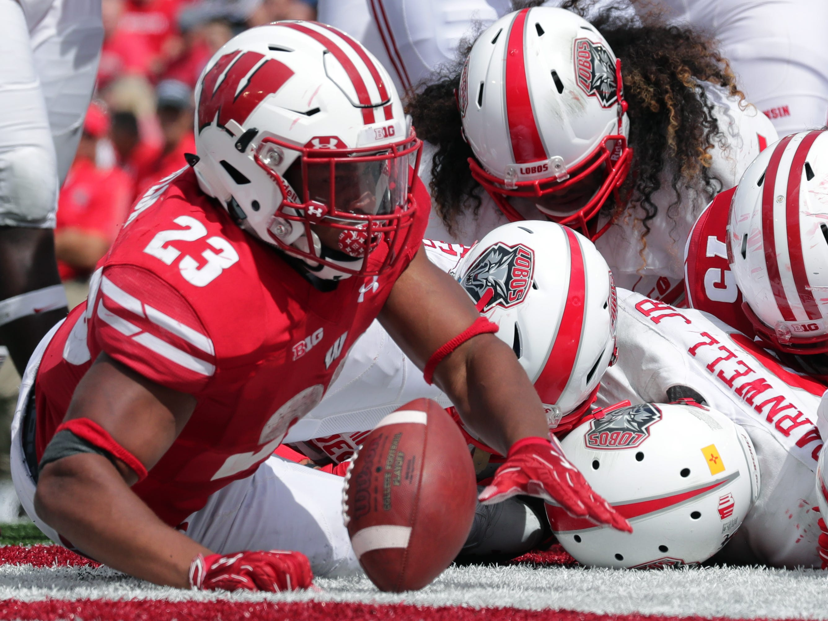 Wisconsin running back Jonathan Taylor bulls his way into the end zone.