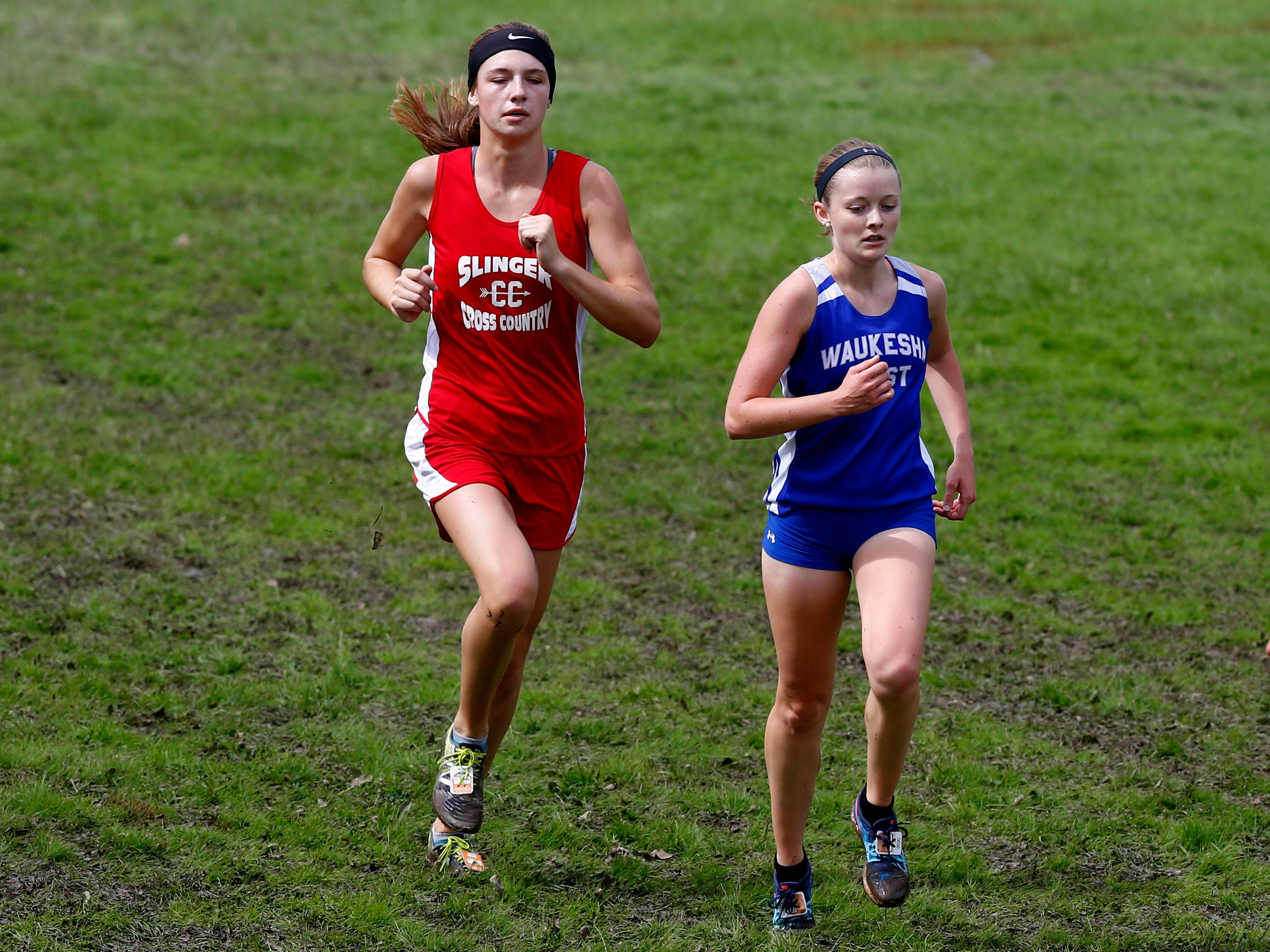 Waukesha West's Allyssa Reeves tries to hold off Slinger's Makaila Groves in the final stretch of the Menomonee Falls Matt Hadler Cross Country Invitational at Rotary Park where Reeves finished fourth and Groves third of 76 runners on Sept. 8.