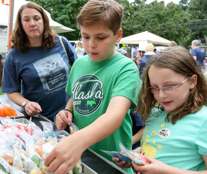 Joshua Dobis, 10, along with his sister Leah Dobis 8, debate on what kind of gummy bears they should buy at the 45th annual Fall Craft Show in Chester on September 8, 2018.