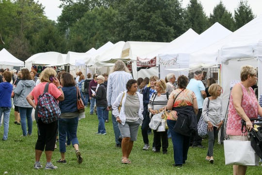 Patrons of the 45th annual Fall Craft Show in Chester walk from tent to tent looking for treasures on Saturday, Sept. 8, 2018.