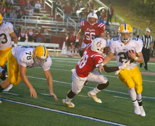 Hills defender Joe Dawson (28) grabs Knolls ballcarrier Michael Kaiser (20) at the Morris Knolls at Morris Hills rivalry football game at Morris Hills HIgh in Rockaway Borough, September 7, 2018.