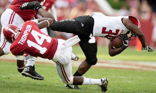 Alabama defensive back Deionte Thompson (14) trips up Arkansas State runningback Marcel Murray (34) in second half action at Bryant Denny Stadium in Tuscaloosa, Ala., on Saturday September 8, 2018.