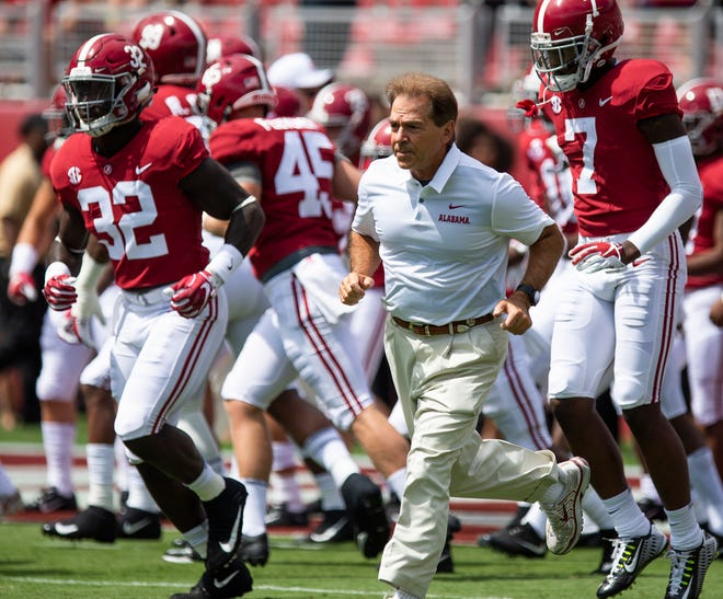 Alabama head coach Nick Saban runs onto the field with the team before warmups at the Arkansas State game at Bryant Denny Stadium in Tuscaloosa, Ala., on Saturday September 8, 2018.