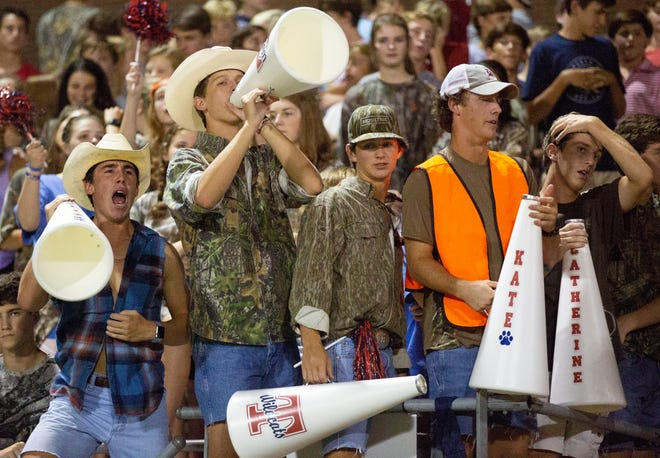 Trinity students cheer during the third quarter against Alabama Christian.