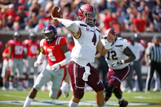 Southern Illinois quarterback Sam Straub (4) passes against Mississippi during the first half of their NCAA college football game on Saturday, Sept. 8, 2018, in Oxford, Miss. (AP Photo/Rogelio V. Solis)