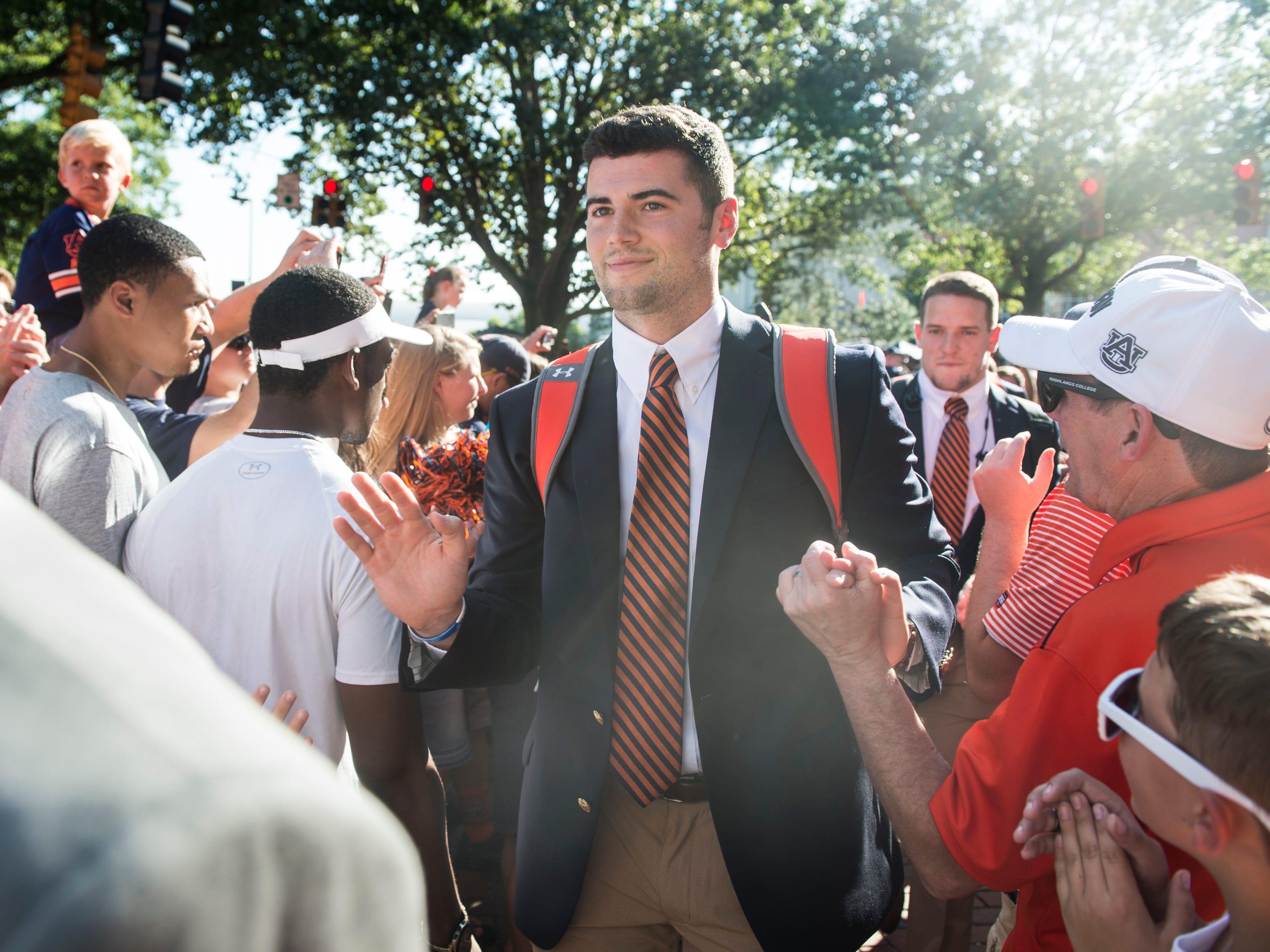 Auburn's Jarrett Stidham (8) makes his way through the Tiger Walk outside Jordan-Hare Stadium in Auburn, Ala., on Saturday, Sept. 8, 2018.