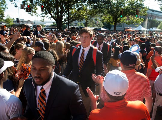Auburn players make their way through the Tiger Walk outside Jordan-Hare Stadium in Auburn, Ala., on Saturday, Sept. 8, 2018.