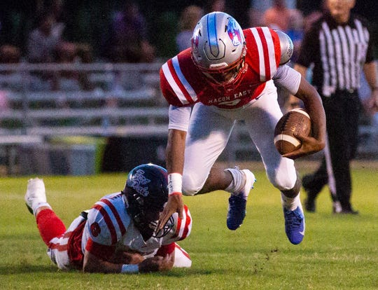 Macon East's Cephus Cleveland prepares to break his fall after tripping over a Fort Dale Academy player.