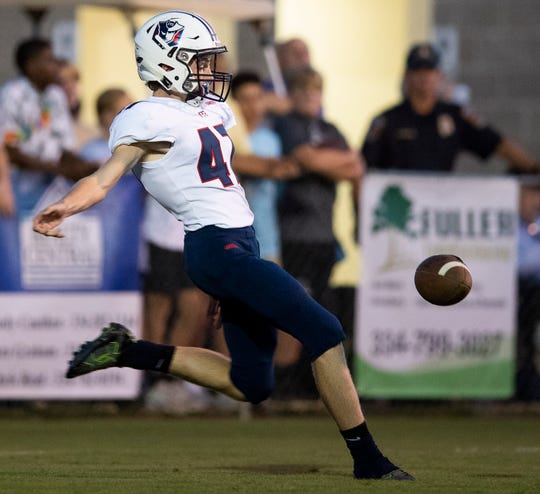Pike Road kicker Aubrey Grace punts against Prattville Christian during first half action in Prattville, Ala., on Friday September 7, 2018.