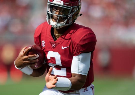 Alabama quarterback Jalen Hurts (2) carries the ball against Arkansas State In first half action at Bryant Denny Stadium in Tuscaloosa, Ala., on Saturday September 8, 2018.