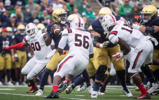 Ball State's Shannon Hall rushes against Notre Dame's Brandon Wimbush on Sept. 8, 2018 at Notre Dame Stadium.