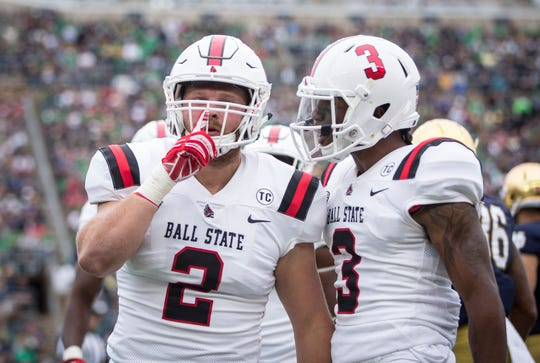 Ball State's Jacob White, left, and Josh Miller during the game against Notre Dame on Sept. 8, 2018 at Notre Dame Stadium.