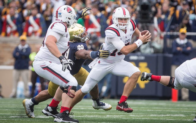 Ball State's Riley Neal looks for running room against Notre Dame during the game at Notre Dame Stadium on Saturday.