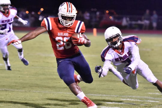 Oakland's Xavier Myers eludes a tackler against RePublic Friday night.
