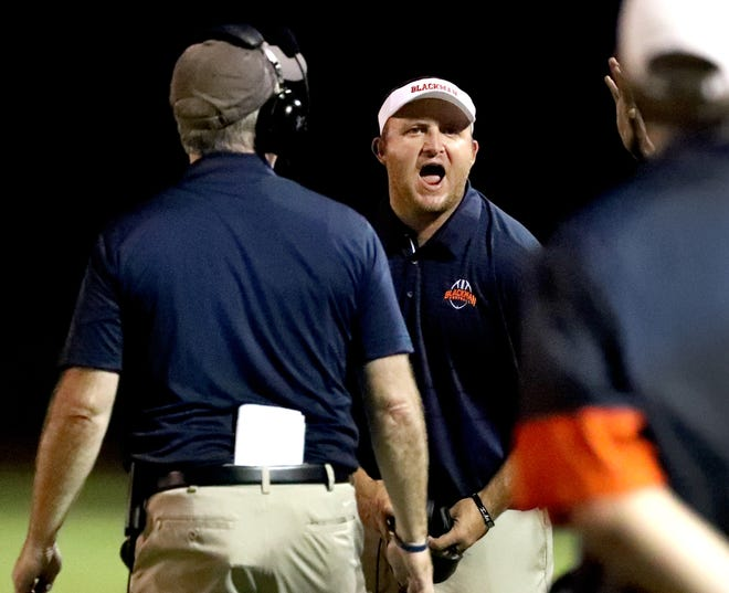 Blackman coach Kit Hartsfield instructs from the sidelines during the first half of Friday's game at Smyrna.