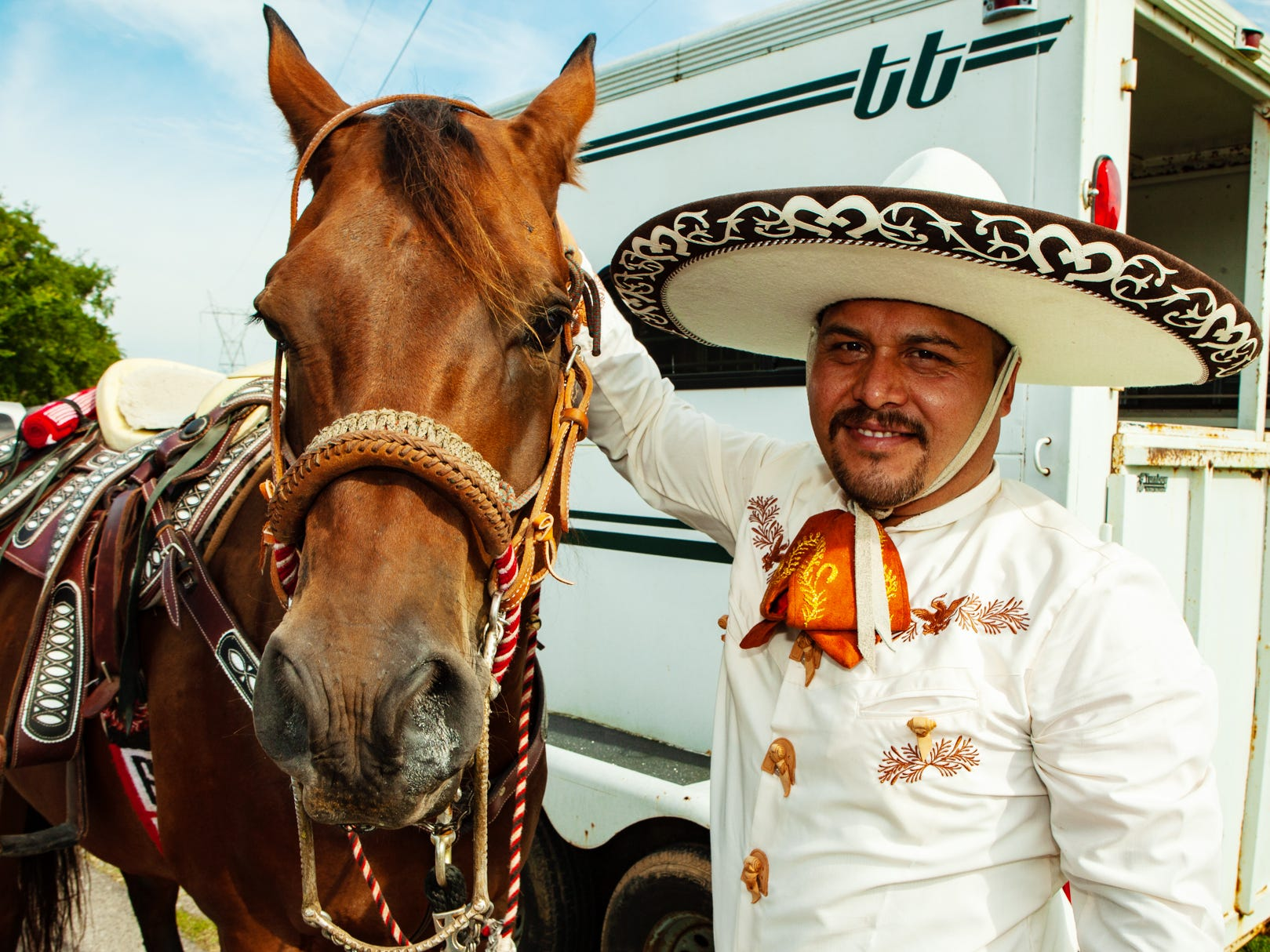 Vicente Fonseca with the La Erradura riding group of La Vergne prepares his horse, Brownie, for the 2018 Old Timer's Parade, held Saturday, Sept. 8.