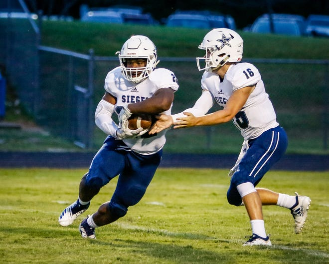Siegel quarterback Tucker Sears hands off to running back Pat Boykins during Friday's 43-20 win at Antioch. Boykins was voted area boys athlete of the week for Sept. 3-8, with Sears a close second.