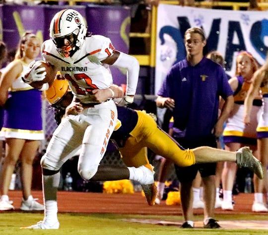 Blackman's Trey Knox (13) runs the ball against Smyrna during the game at Smyrna High School on Friday, Sept. 7, 2018.