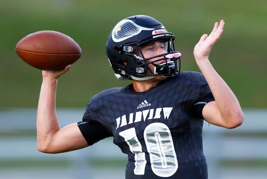 Fairview's Brock Harris throws a pass during warmups before their game against Waverly Friday, Sept. 7, 2018, in Fairview, Tenn.