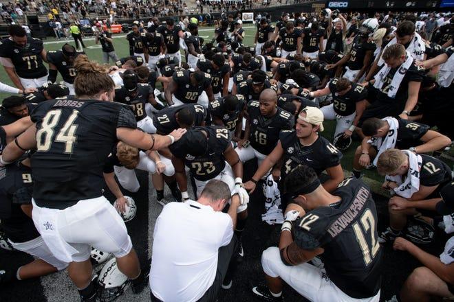 Vanderbilt players gather to pray after Vanderbilt's victory over Nevada at Vanderbilt University in Nashville, Tenn., Saturday, Sept. 8, 2018.