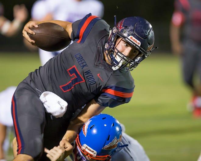 Creek Wood quarterback Mitch Duke runs the ball against Harpeth.