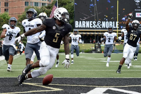 Vanderbilt running back Ke'Shawn Vaughn (5) runs in a touchdown against Nevada during the second half at Vanderbilt University in Nashville, Tenn., Saturday, Sept. 8, 2018.