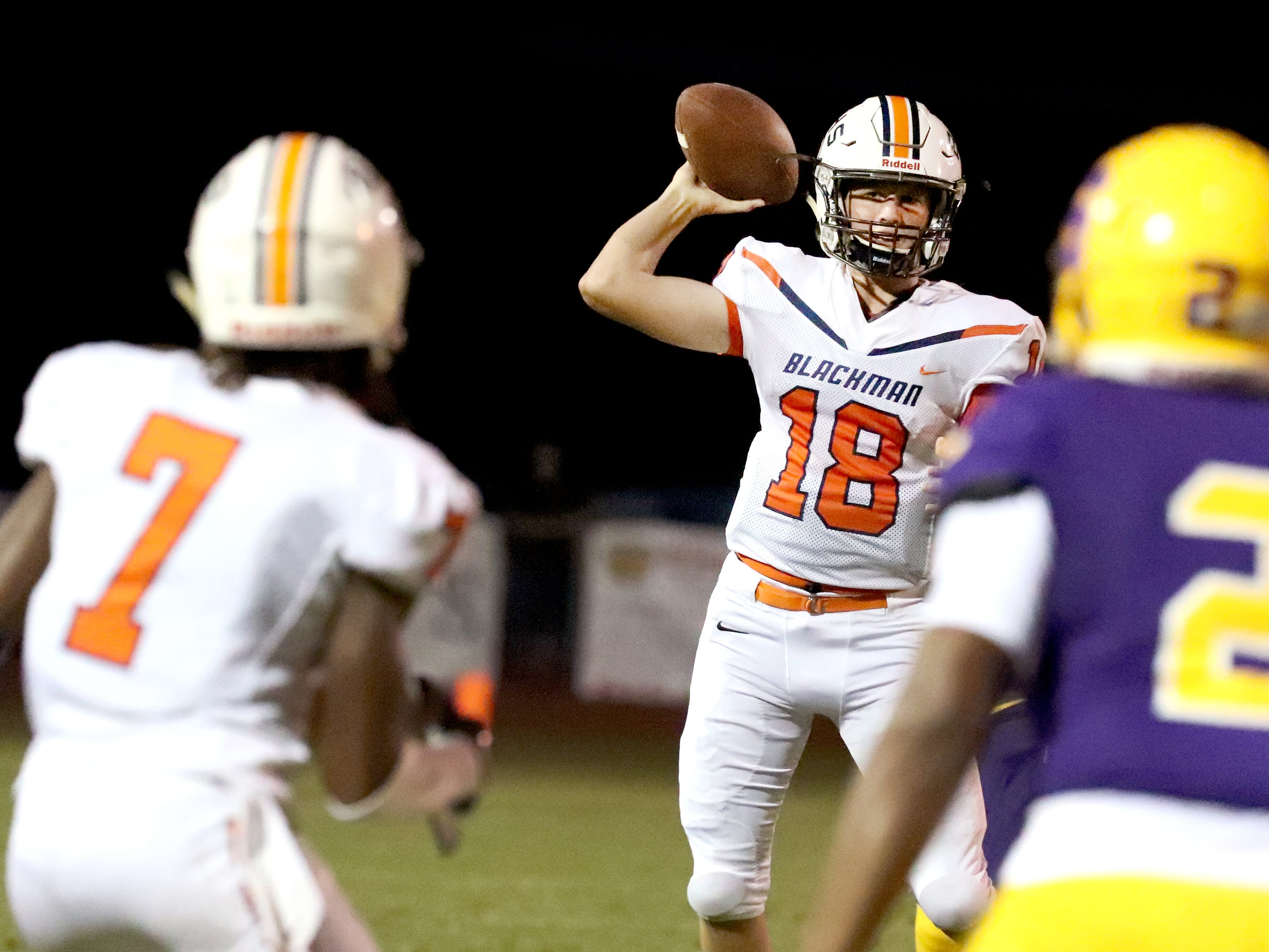 Blackman's quarterback Drew Beam (18) attempts to pass the ball to Michaleous Elder (7) in the first half of the game against Smyrna at Smyrna High School on Friday, Sept. 7, 2018.