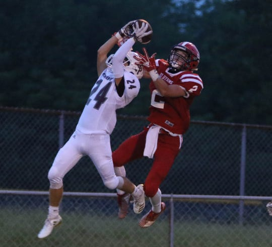 East Robertson's Tyler Ayers goes up to attempt to intercept a pass as Jo Byrns' Blake Jernigan tries to make a play.
