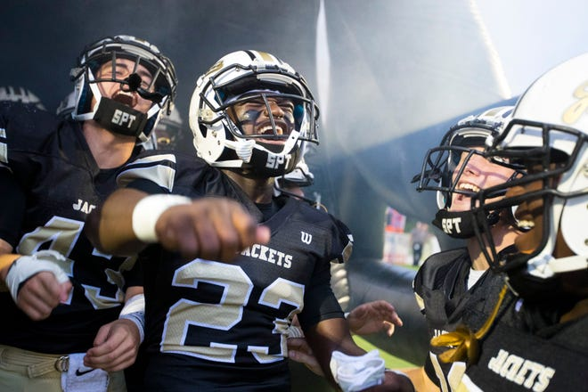Springfield's Dayron Johnson (23) yells with his teammates before Springfield's game against Station Camp at Springfield High School in Springfield on Friday, Sept. 7, 2018.