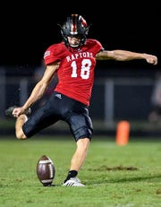 Ravenwood's Luke Akers (18) kicks against Page during the first half at Ravenwood High School in Brentwood, Tenn., Friday, Sept. 7, 2018.