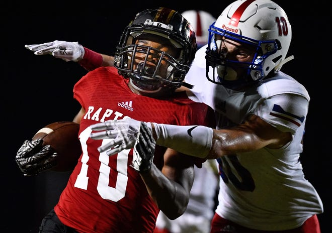 Ravenwood's Tony Rice (10) is tackjled by Page's Michael Burdick (10) during the first half at Ravenwood High School in Brentwood, Tenn., Friday, Sept. 7, 2018.