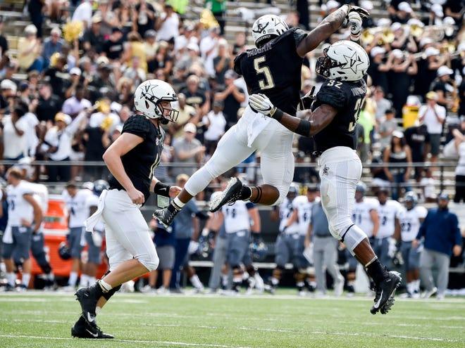 Vanderbilt running back Ke'Shawn Vaughn (5) celebrates scoring a touchdown against Nevada with running back Jamauri Wakefield (32) during the first half at Vanderbilt University in Nashville, Tenn., Saturday, Sept. 8, 2018.