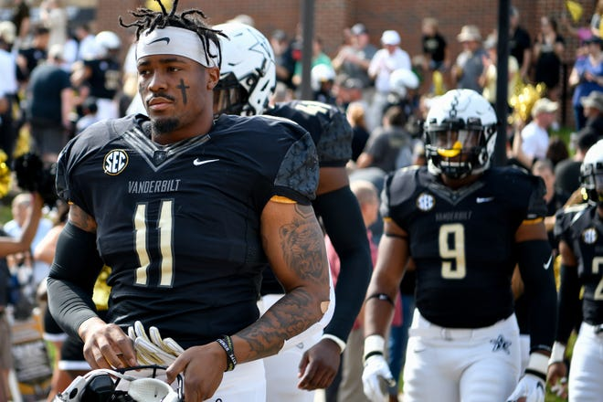 Vanderbilt linebacker Charles Wright (11) heads into the stadium before the game against Nevada on Saturday.
