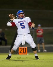 Harpeth quarterback Thomas Sloan sets up to pass to his receiver against Creek Wood.