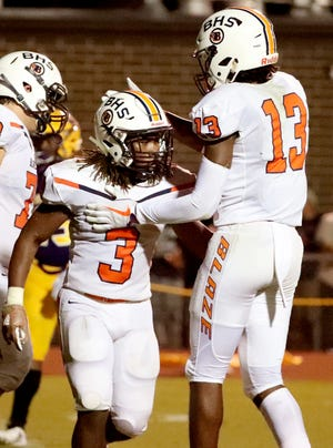 Blackman's Trey Knox (13) congratulates Tamicus Napier (3) for Napier's touchdown against Smyrna during the game at Smyrna High School on Friday, Sept. 7, 2018.