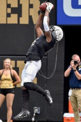 Vanderbilt wide receiver Kalija Lipscomb (16) receives a pass for a touchdown against Nevada during the second half at Vanderbilt University in Nashville, Tenn., Saturday, Sept. 8, 2018.