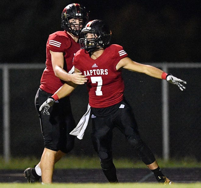 Ravenwood's Shane Craig (7) celebrates his touchdown against Page with Jordan Smith (44) during the second half at Ravenwood High School in Brentwood, Tenn., Friday, Sept. 7, 2018.