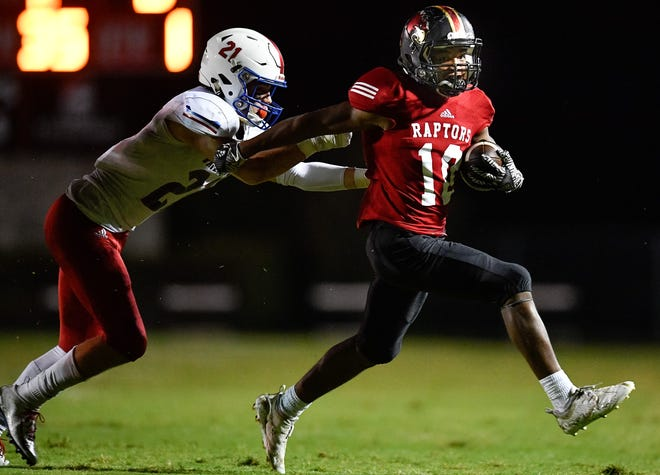 Ravenwood's Tony Rice (10) evades Page's Colby Burns (21) during the first half at Ravenwood High School in Brentwood, Tenn., Friday, Sept. 7, 2018.